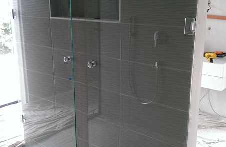 Fold away shower screen