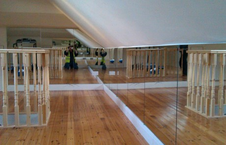 Wall of Mirrors in Converted Attic